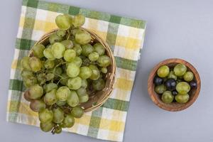 Grapes on plaid cloth on gray background photo