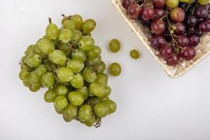 Assorted grapes on white background