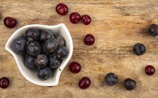 Assorted berries on a wooden background photo