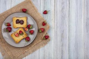 Berries and toast on a wooden background with copy space