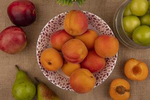 Assorted fruit on sackcloth background