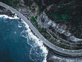 Aerial view of a road near the ocean