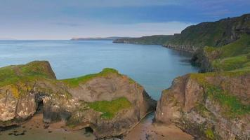 The big rocks of the cliff in Carrick-a-Rede