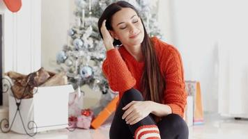 Young woman relaxing over the Christmas season video