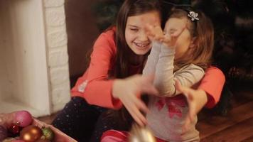 sisters are preparing for the new year, choose Christmas decorations video