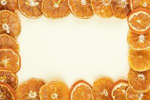 Top view of a frame made of dried orange slices