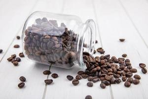 Side view of dark roasted coffee beans photo