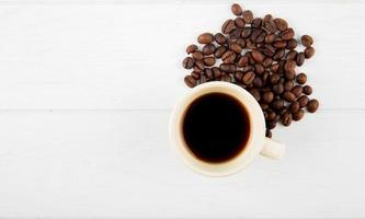 Top view of a cup of coffee and coffee beans photo