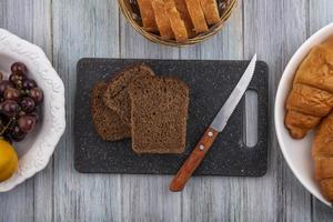 Top view of rye bread slices and knife