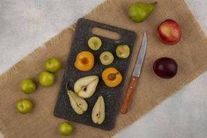 Top view of fruit on cutting board
