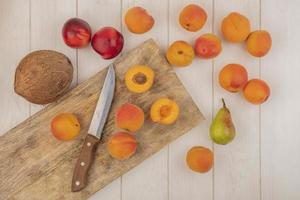 Top view of apricots on cutting board