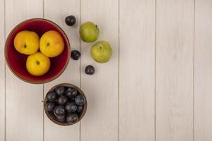 Top view of fresh peaches and sloes with cherry plums