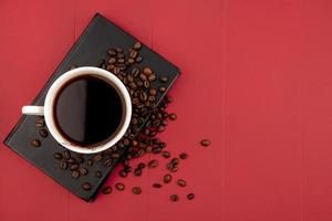 Top view of a cup of coffee with coffee beans