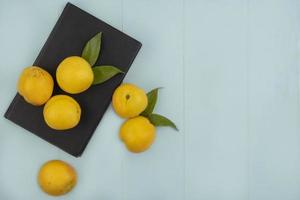 Top view of fresh yellow peaches isolated on a blue background with copy space