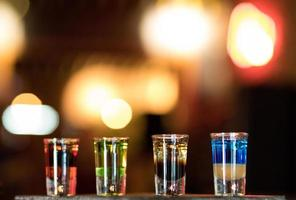 Colorful shot glasses on a bar