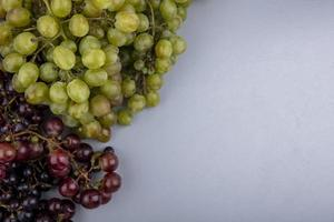 Top view of grapes on gray background with copy space