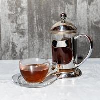vaso de té y tetera