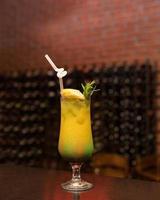 Tasty pineapple juice cocktail on table