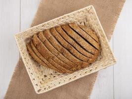 Top view of sliced brown seeded cob in basket