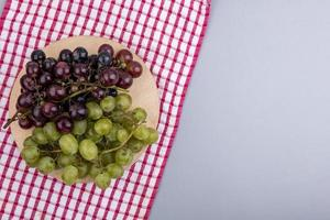 Top view of grapes on cutting board