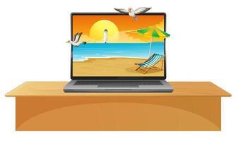 portátil en la mesa con playa en pantalla