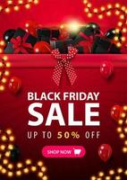 Black Friday banner with big pile of gifts vector