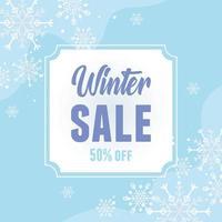 Venta de invierno y banner publicitario con copos de nieve. vector