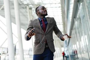Happy African American business man dances photo