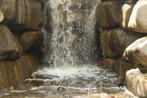 Waterfall falling on rocks