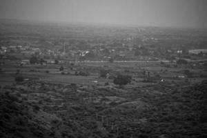 Grayscale aerial view of a city