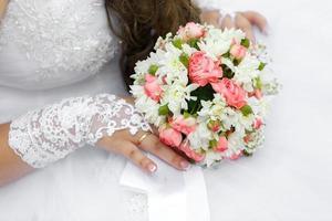 Wedding bunch of flowers in hands  the bride