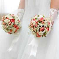 Wedding bunch  flowers in hands of the bride