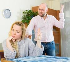Couple having quarrel indoor photo