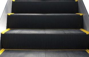 Escalator in close-up shot.Stairs  rowed or lined things. photo