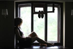 girl in the window monochrome portrait