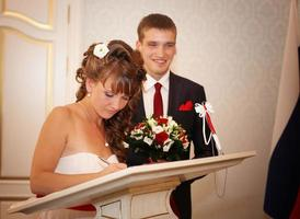 bride and groom wear a ring
