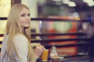 The beautiful blonde in a cafe, holiday diet
