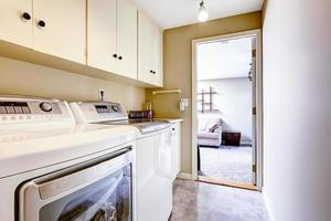 Small laundry area with cabinets