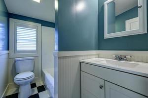 Blue and white bathroom interior. photo