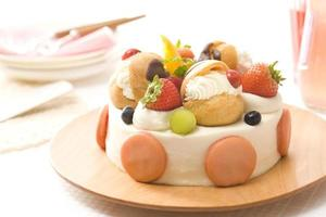 Fancy cake with macaroon and cream puff