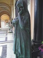 Women sculpture on the grave refreshed photo