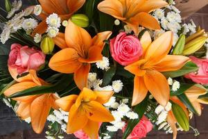 beautiful bridal bouquet of lilies and roses at a wedding