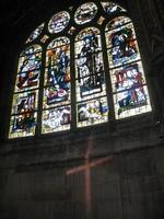 Gothic church decorated window and cross photo