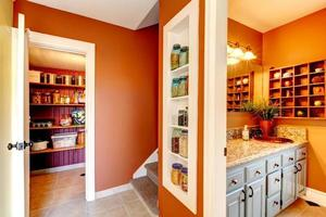 Rust and white small hallway with designed built-in shelves