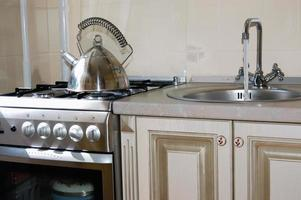 Gas stove. Wash. Kitchen equipment. photo