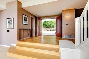 Spacious entrance hallway with open door