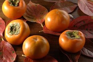 fallen leaves and persimmon