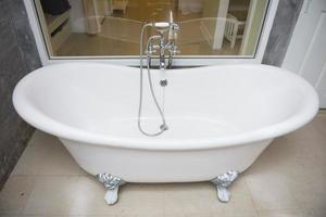 vintage bathtub with faucet and shower in bathroom
