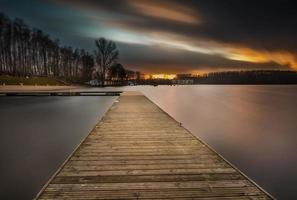 Lake landscape with jetty. Long time exposure photo