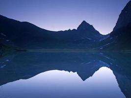 Mountain range mirroring at daybreak